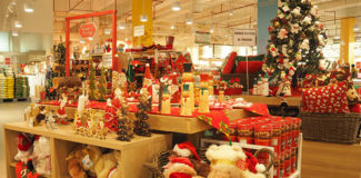 Christmas merchandising display set-up in middle of a department store